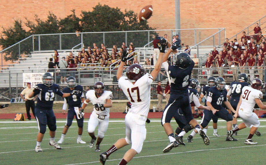 Boerne Champion receiver Cort Cowart (2) and Dripping Springs defensive back Weston Murray (17) both try to come down with a high pass thrown by Charger quarterback Alex Flores. Champion defeated the Tigers 48-28. Photo: Mike Reeder / For The Northwest Weekly