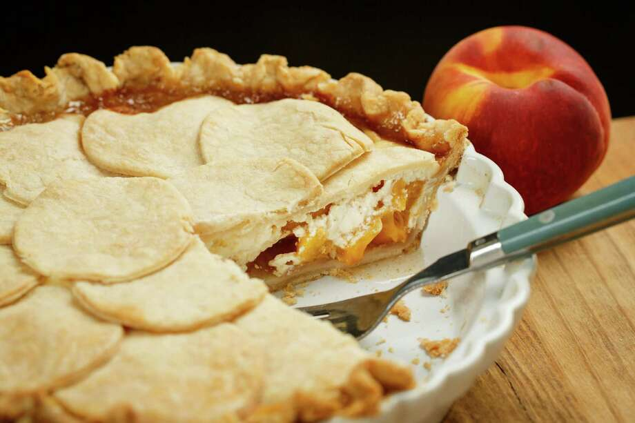 Peach pie or cheesecake? You don't have to choose. The Peacheesy Pie, a scrumptious dessert from Pillsbury, combines the two. Photo: Michael Paulsen, Staff / © 2013 Houston Chronicle