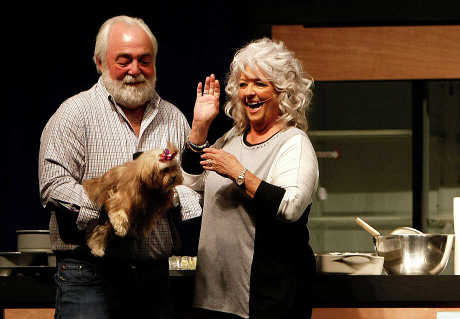 Paula Deen and her husband, Michael Groover, introduced their dog Lulu during her cooking demonstration at MetroCooking last year. Deen's presentation (sans Groover) is likely to be different this time around. Photo: Johnny Hanson, Staff / 2012  Houston Chronicle