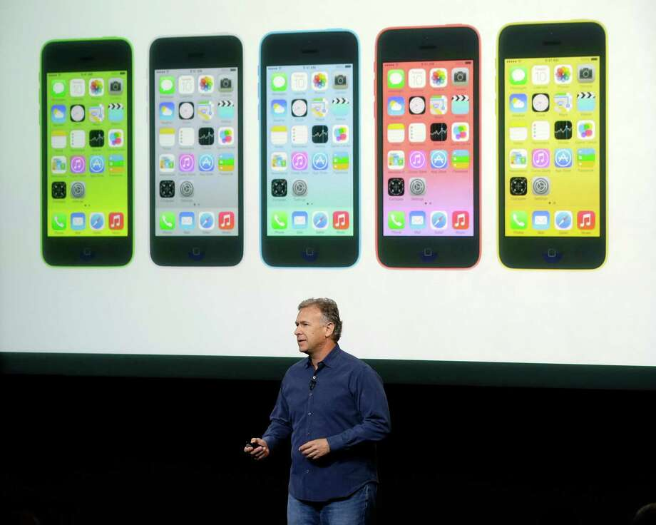 "Phil Schiller, Apple's senior vice president of worldwide product marketing, speaks on stage during the introduction of the new iPhone 5C in Cupertino, Calif., Tuesday, Sept. 10, 2013. Apple's latest iPhones will come in a bevy of colors and two distinct designs, one made of plastic and the other that aims to be ""the gold standard of smartphones"" and reads your fingerprint.  (AP Photo/Marcio Jose Sanchez) ORG XMIT: FX112 Photo: Marcio Jose Sanchez / AP"