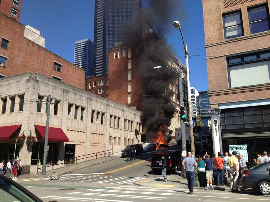 Cars burn on James Street in downtown Seattle after a box truck smashed into the cars when traveling down the hill. Photo: Rebecca Bridge, Courtesy Photo / Courtesy photo