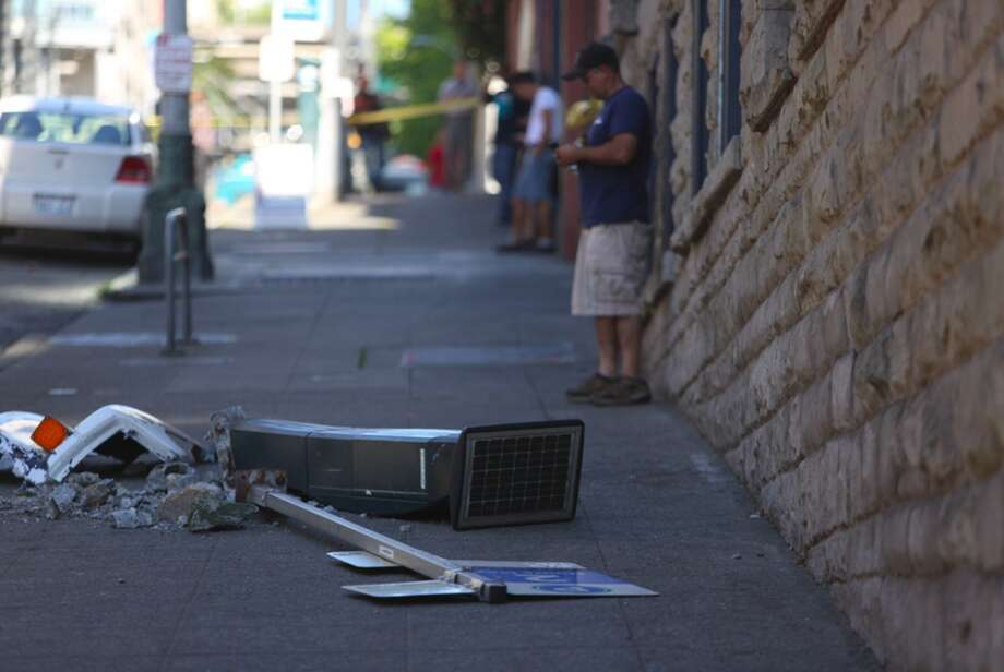 A parking meter is shown after it was knocked from its base during the wreck. Photo: JOSHUA TRUJILLO, SEATTLEPI.COM