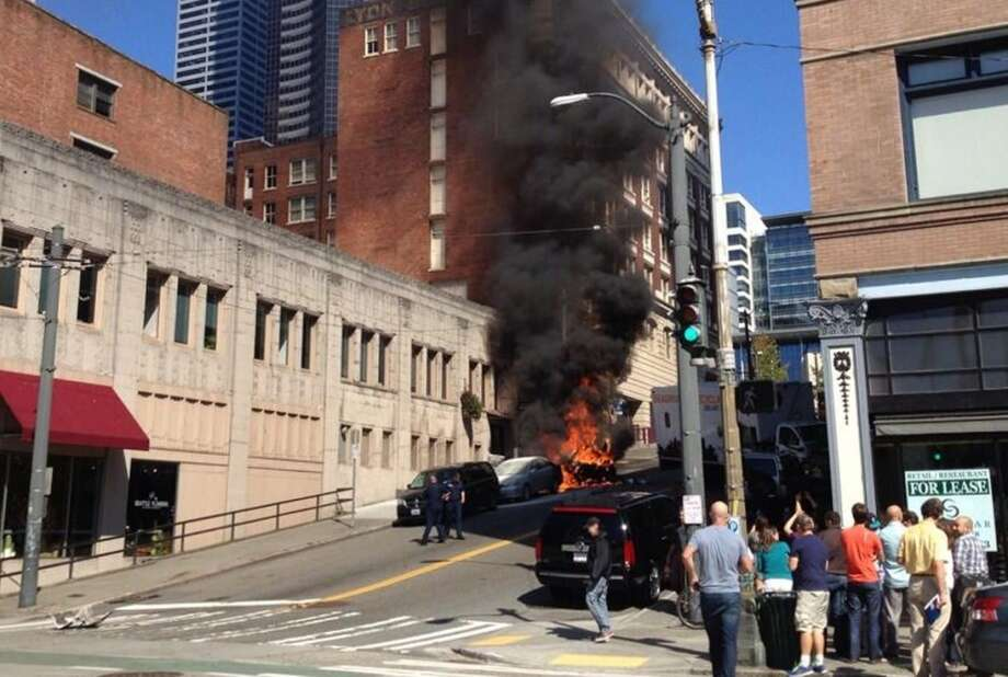 Cars burn on James Street in downtown Seattle after a box truck smashed into the cars when traveling down the hill. Photo: Rebecca Bridge, Courtesy Photo