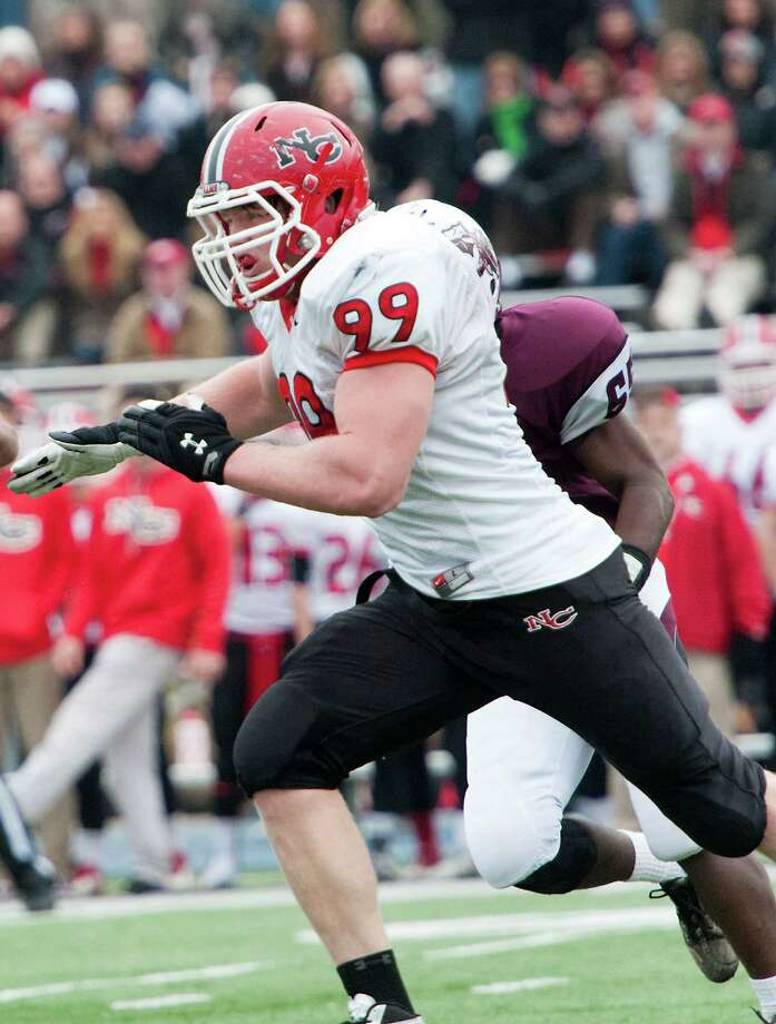 New Canaan high school defensive lineman Connor Buck returns for the Rams in 2013. Photo: Mark Conrad / Stamford Advocate Freelance