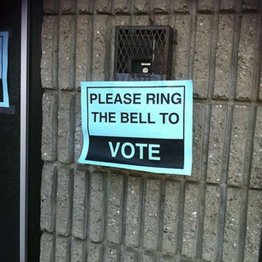 A sign of the times at some polling places in Bridgeport. Photo: Linda Conner Lambeck