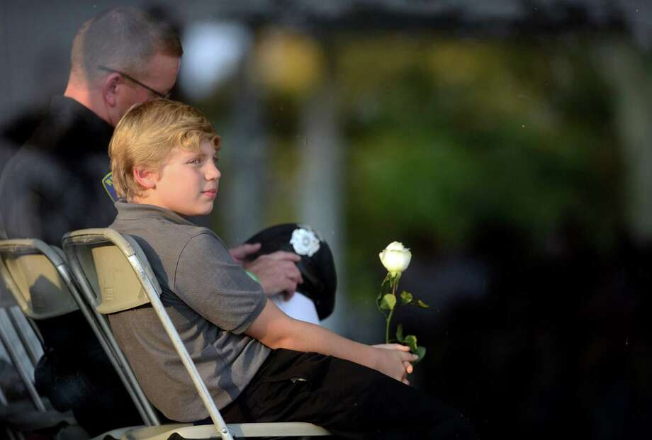 Bradley Vadas, 11, of Newtown, born two weeks after 9/11 and named for his uncle, 9/11 victim Bradley Vadas, looks out at the water as victims' names are read during the annual 9/11 Memorial Service Tuesday, September 10, 2013 at Connecticut's 9/11 Living Memorial at Sherwood Island State Park in Westport, Conn. Photo: Autumn Driscoll / Connecticut Post