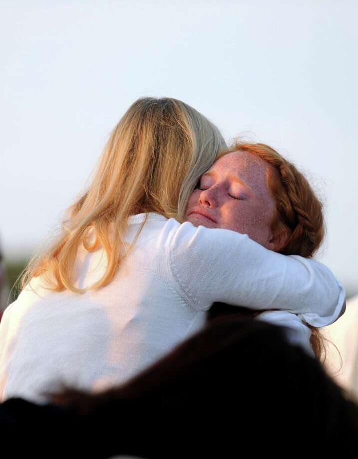 Emma Hunt, 13, embraces her aunt, Debra Kelly Woodward, during the annual Sept. 11 Memorial Service Tuesday, Sept. 10, 2013, at Sherwood Island State Park in Westport, Conn. Emma's father, William Christopher Hunt, of Norwalk, died in Tower 2 of the World Trade Center. Photo: Autumn Driscoll / Connecticut Post