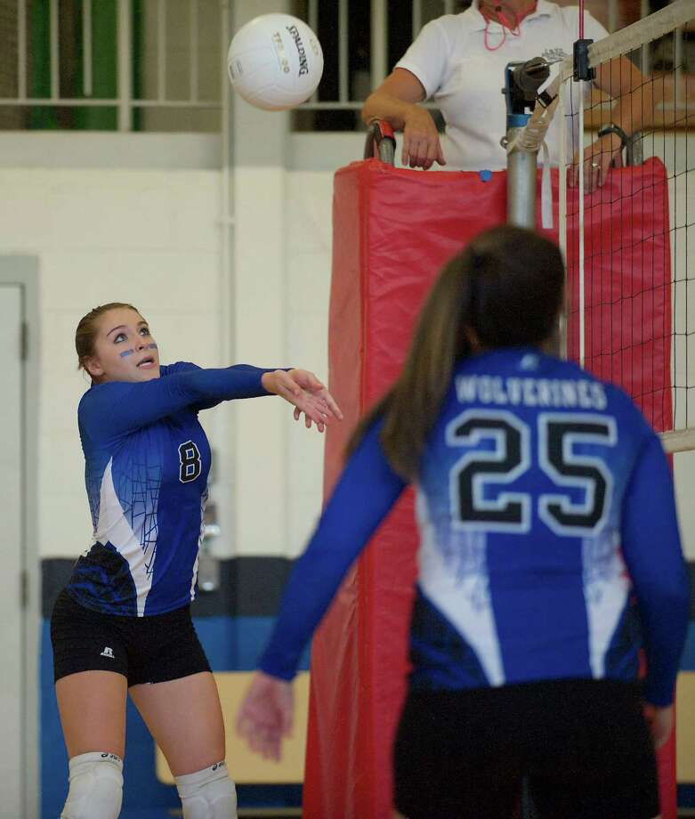 Abbott Tech's Gabby Cecere sets the ball to teammate Katrina Fyler during a girls high school volleyball game between O'Brien Tech, from Ansonia, and Abbott Tech, from Danbury. On Tuesday September 10, 2013 in Danbury Conn. Photo: H John Voorhees III