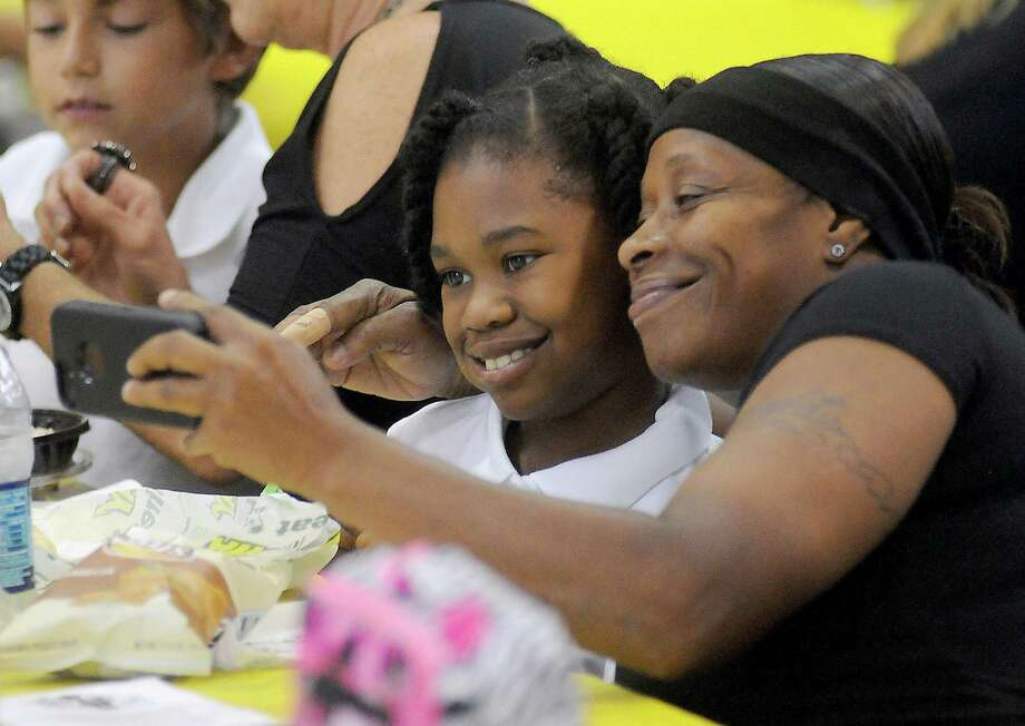 Enga Neal takes a photo of herself with her granddaughter Jaela Hines at lunchtime during National Grandparents' Day at Oak Forest Elementary School Tuesday Sept. 10, 2013. Photo: Dave Rossman, For The Houston Chronicle / © 2013 Dave Rossman