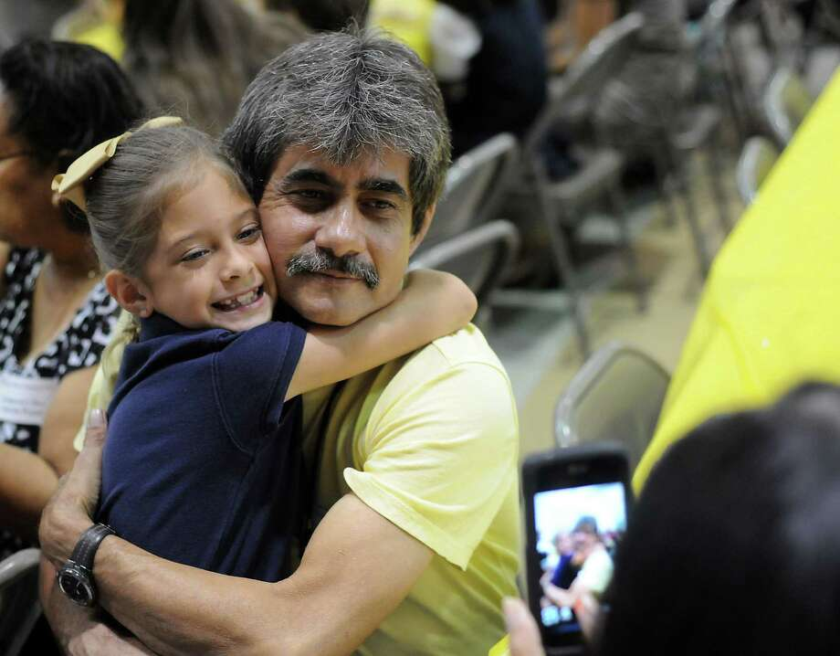 Pablo Perez has a photo taken with his granddaughter Izabella during lunchtime on National Grandparents' Day at Oak Forest Elementary School Tuesday Sept. 10, 2013. Photo: Dave Rossman, For The Houston Chronicle / © 2013 Dave Rossman