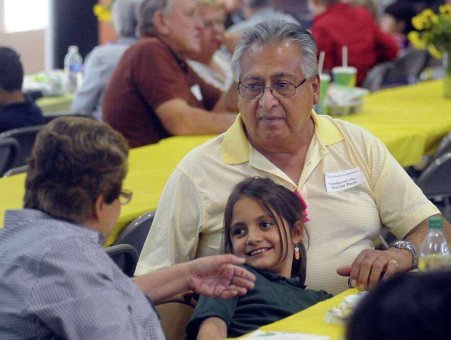 Diana and Carlos Baldovino spend time with their granddaughter Sarah Baldovino during lunch on National Grandparents' Day at Oak Forest Elementary School Tuesday Sept. 10, 2013. Photo: Dave Rossman, For The Houston Chronicle / © 2013 Dave Rossman
