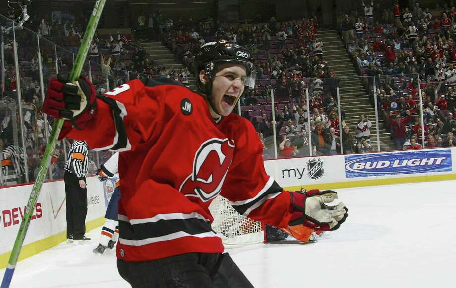 EAST RUTHERFORD, NJ - JANUARY 21:  Zach Parise #9 of the New Jersey Devils celebrates after assisting on a goal by teammate Sergei Brylin #18 during the first period against the New York Islanders on January 21, 2006 at the Continental Airlines Arena in East Rutherford, New Jersey.  (Photo by Mike Stobe/Getty Images) Photo: Mike Stobe / Getty Images North America