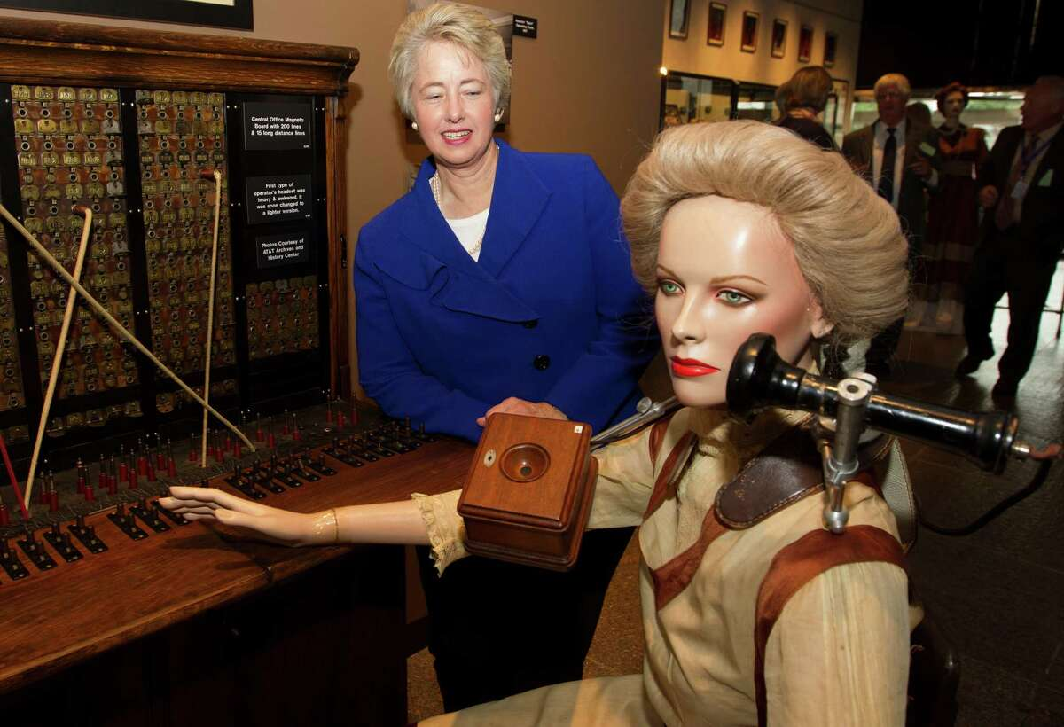 Mayor Annise Parker looks at an old fashion telephone operator exhibit at the AT&T local telephone museum at the AT&T headquarters on Tuesday, Sept. 10, 2013, in Bellaire.