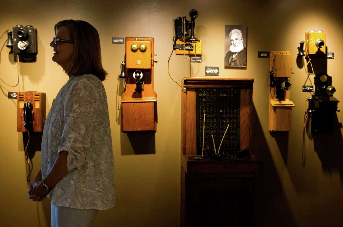 AT&T Regional Vice President Alice Aanstoos views the antique telephones exhibit at the local telephone museum at the AT&T headquarters on Tuesday, Sept. 10, 2013, in Bellaire.