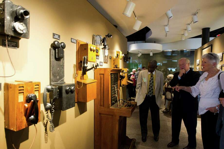 Guest view the antique telephones exhibit at the opening of the local telephone museum at the AT&T headquarters on Tuesday, Sept. 10, 2013, in Bellaire. Photo: J. Patric Schneider, For The Chronicle / © 2013 Houston Chronicle