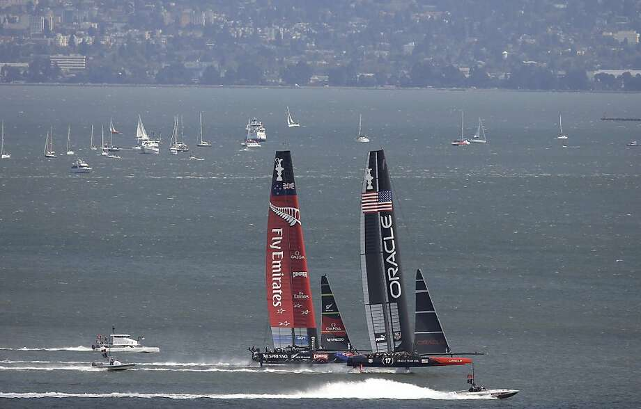 Oracle USA is the home team, but feisty Emirates Team New Zealand is winning many hearts. Photo: Jeff Chiu, Associated Press