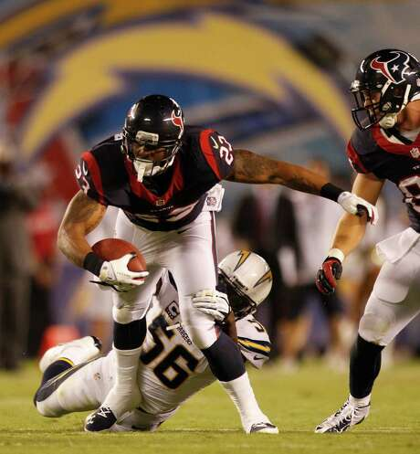 Arian Foster, being brought down by Chargers linebacker Donald Butler, had trouble getting untracked Monday and finished with 57 yards on 18 carries. Photo: Brett Coomer, Staff / © 2013  Houston Chronicle
