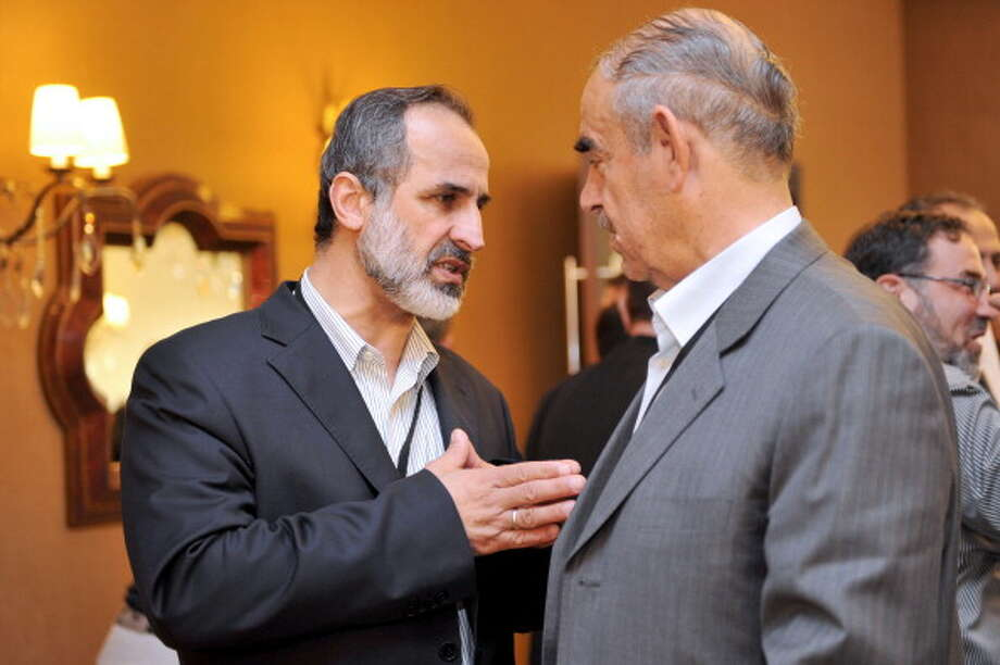 Opposition forces look to overthrow the Assad regime to start a new government based on the teachings of the Quran and sharia law. Ahmed Moaz al-Khatib (left), a former president of the Syrian National Coalition, is a prominent leader of the Syrian opposition. Photo: AFP, AFP/Getty Images / 2013 AFP