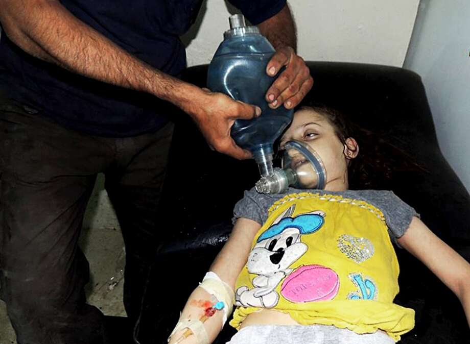 In effort to put down the rebel forces, the Syrian government in August 2013 launched chemical weapons attacks, now believed to include sarin gas, upon its people. At least 1,400 were believed killed, including children. Photo: Uncredited, ASSOCIATED PRESS