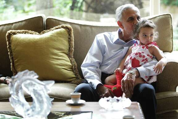 Houston developer Bassam Barazi watches the latest from the country of his birth with granddaughter Leah Abdeen.