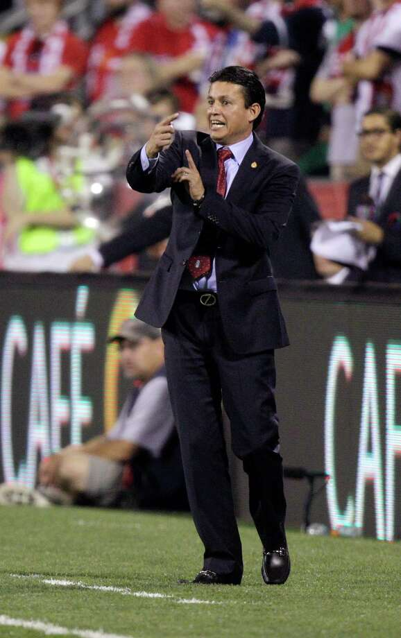 Mexico manager Luis Fernando Tena instructs his team against the United States during the first half of a World Cup qualifying soccer match Tuesday, Sept. 10, 2013, in Columbus, Ohio. (AP Photo/Jay LaPrete) Photo: Jay LaPrete, Associated Press / FR52593 AP
