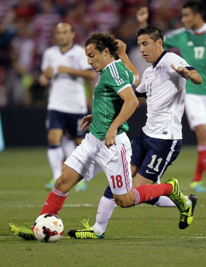 Mexico's Andres Guardado, left, kicks the ball away from United States' Alejandro Bedoya during the first half of a World Cup qualifying soccer match Tuesday, Sept. 10, 2013, in Columbus, Ohio. (AP Photo/Jay LaPrete) Photo: Jay LaPrete, Associated Press / FR52593 AP