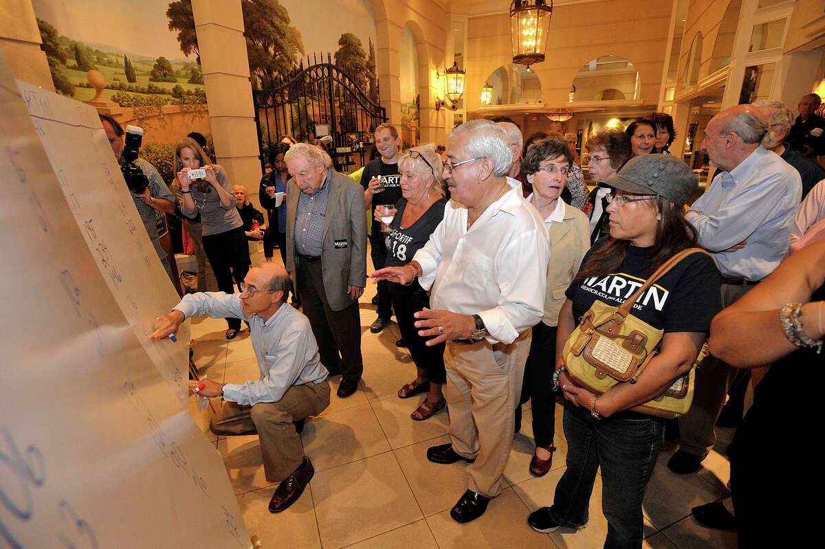 David Martin supporters watch as the Democratic mayoral primary poll numbers come in during the Martin campaign party at the Stamford Marriott on Tuesday, Sept. 10, 2013. David Martin beat William Tong and will face former Lt. Gov. Michael Fedele on the November ballot.