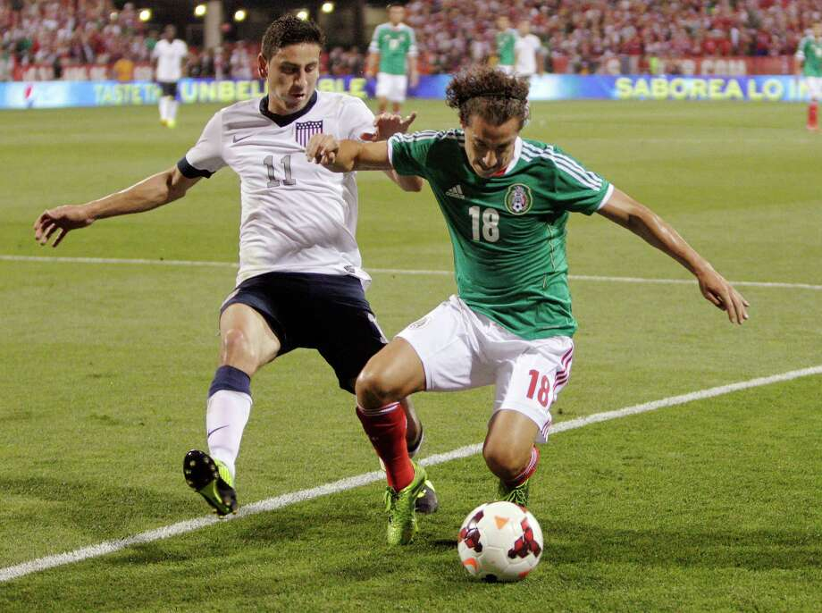 The United States' Alejandro Bedoya, left, and Mexico's Andrés Guardado chase a loose ball during the first half of a World Cup qualifying soccer match Tuesday, Sept. 10, 2013, in Columbus, Ohio. (AP Photo/Jay LaPrete) Photo: Jay LaPrete, Associated Press / FR52593 AP