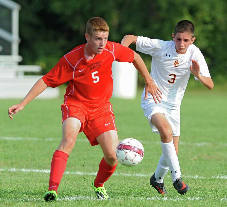 From left, Guilderland's Connor O'Brien battles for the ball with Colonie's Jack Blanchard during a soccer game on Tuesday, Sept. 10, 2013 in Colonie, N.Y. (Lori Van Buren / Times Union) Photo: Lori Van Buren / 00023815A