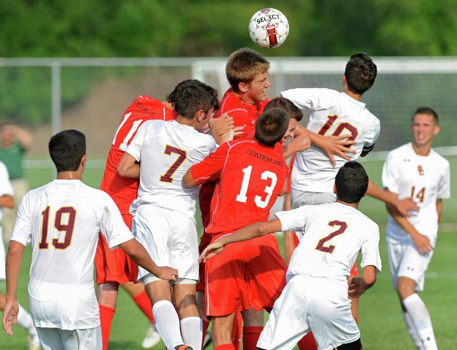 Guilderland's John Hanlon, center, is on the top to head the ball first in a soccer game against Colonie on Tuesday, Sept. 10, 2013 in Colonie, N.Y. (Lori Van Buren / Times Union) Photo: Lori Van Buren / 00023815A