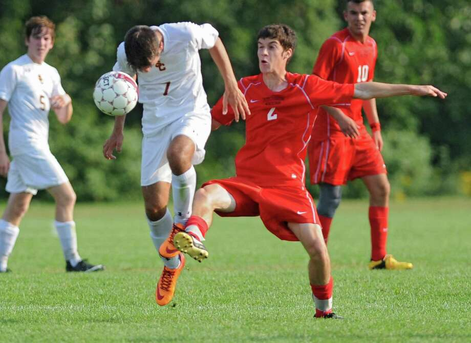 Colonie's Aaron Muia, left, battles for the ball with Guilderland's Andrew Burns during a soccer game on Tuesday, Sept. 10, 2013 in Colonie, N.Y. (Lori Van Buren / Times Union) Photo: Lori Van Buren / 00023815A