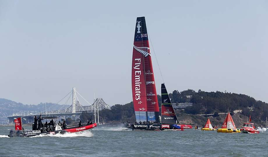 Emirates Team New Zealand crosses the finish line for its fourth victory in five races in the America's Cup finals. Photo: Beck Diefenbach, Special To The Chronicle
