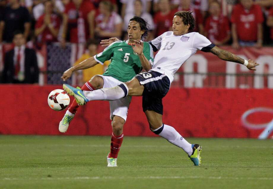 United States' Jermaine Jones, right, and Mexico's Fernando Arce scramble for a loose ball during the second half of a World Cup qualifying soccer match Tuesday, Sept. 10, 2013, in Columbus, Ohio. The United States defeated Mexico 2-0. (AP Photo/Jay LaPrete) Photo: Jay LaPrete, Associated Press / FR52593 AP