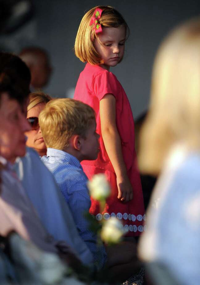 A young girl looks over her shoulder at a companion Tuesday during a service at Connecticut's 9/11 Living Memorial at Sherwood Island State Park. The ceremony honored Connecticut's victims of September 11, 2001 terrorist attacks. Photo: Autumn Driscoll / Connecticut Post