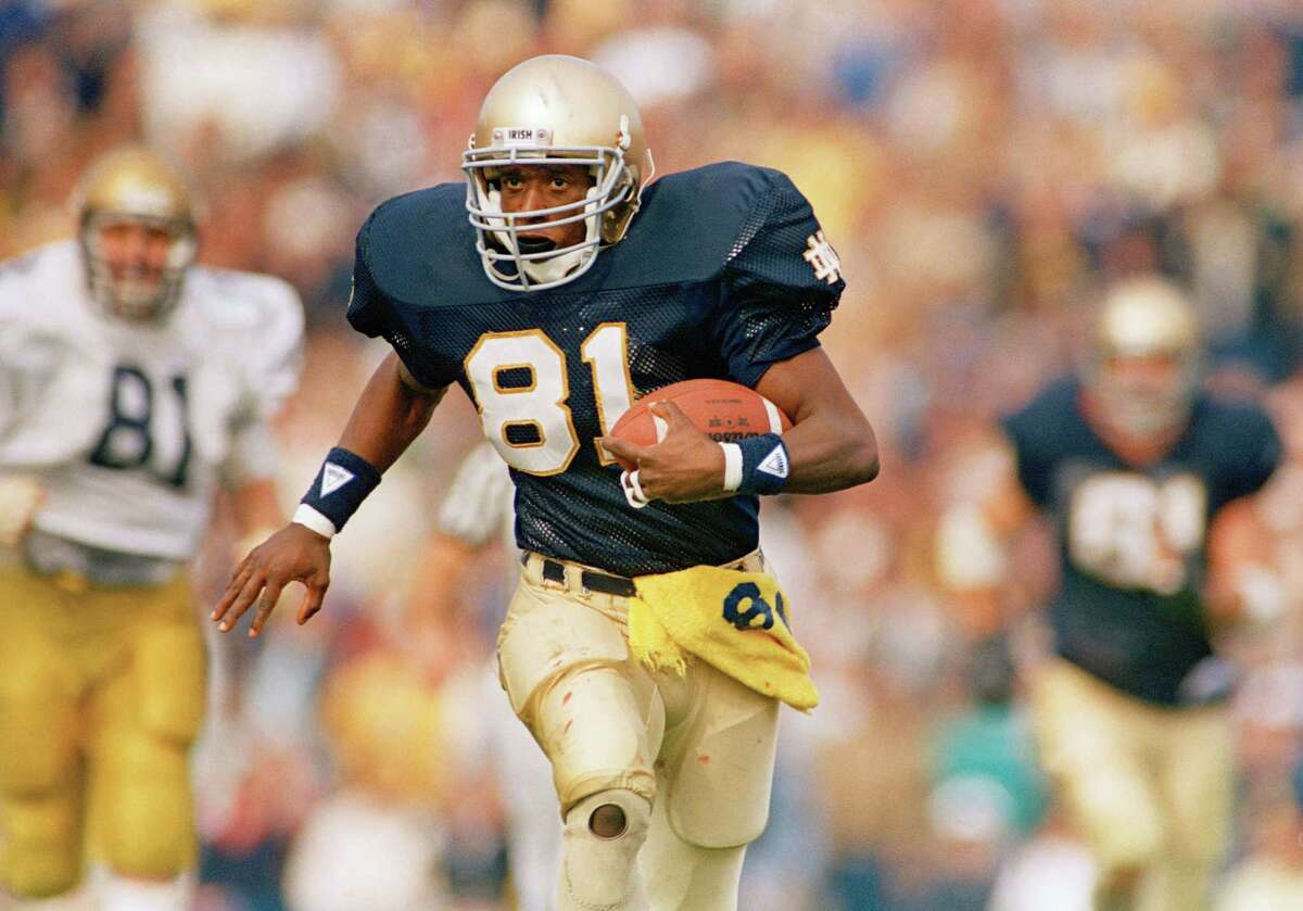 FILE - This is a 1987 file photo showing Notre Dame football player Tim Brown. Brown leads a class of 24 players and coaches being enshrined in the College Football Hall of Fame(AP Photo/File)