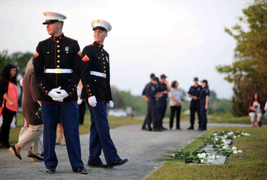 The annual 9/11 memorial service pays tribute to Connecticut's victims of September 11, 2001 at Connecticut's 9/11 Living Memorial Tuesday, September 10, 2013 at Sherwood Island State Park in Westport, Conn. Photo: Autumn Driscoll / Connecticut Post