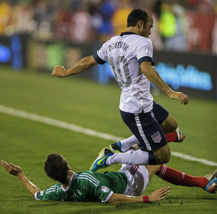Landon Donovan (10) of the United States is tripped up by Hiram Mier of Mexico in the second half during 2014 FIFA World Cup Qualifying at Columbus Crew Stadium in Columbus, Ohio, on Tuesday, September 10, 2013. The U.S. won, 2-0. (Alex Holt/Columbus Dispatch/MCT) Photo: Alex Holt, McClatchy-Tribune News Service / Columbus Dispatch