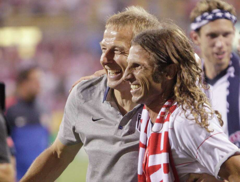 United States' manager Jurgen Klinsmann, left, is congratulated by former player Frankie Hejduk after the U.S. beat Mexico 2-0 in a World Cup qualifying soccer match Tuesday, Sept. 10, 2013, in Columbus, Ohio. (AP Photo/Jay LaPrete) Photo: Jay LaPrete, Associated Press / FR52593 AP