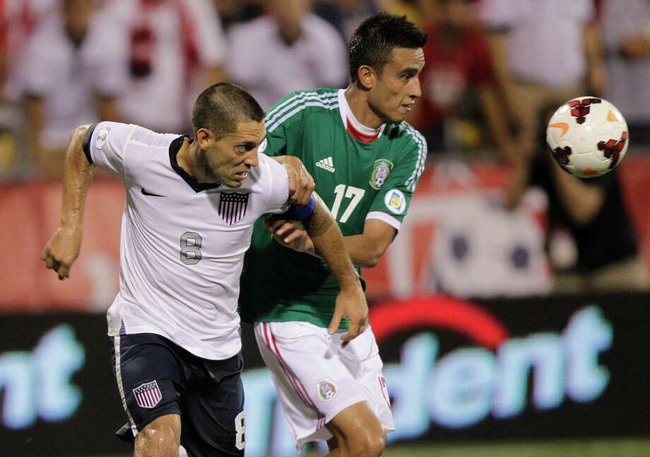 United States' Clint Dempsey, left, and Mexico's Jesus Zavala chase a loose ball during the second half of a World Cup qualifying soccer match Tuesday, Sept. 10, 2013, in Columbus, Ohio. (AP Photo/Jay LaPrete) Photo: Jay LaPrete, Associated Press / FR52593 AP