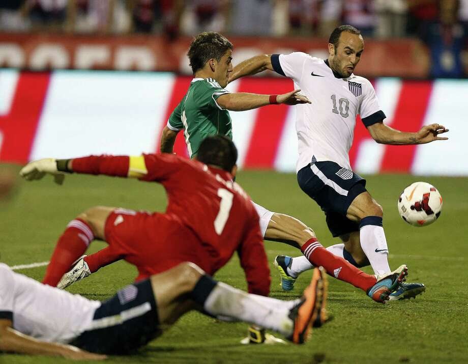 Landon Donovan (10) of the United States gets past Hiram Mier of Mexico, setting up a score in the second half during 2014 FIFA World Cup Qualifying at Columbus Crew Stadium in Columbus, Ohio, on Tuesday, September 10, 2013. The U.S. won, 2-0. (Kyle Robertson/Columbus Dispatch/MCT) Photo: Kyle Robertson, McClatchy-Tribune News Service / Columbus Dispatch