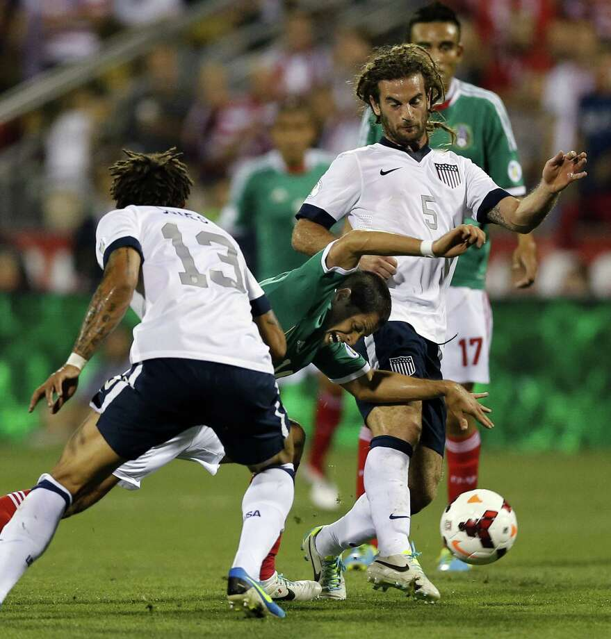 Jermaine Jones (13) of the United States fouls Javier Hernandez of Mexico in the first half during 2014 FIFA World Cup Qualifying at Columbus Crew Stadium in Columbus, Ohio, on Tuesday, September 10, 2013. The U.S. won, 2-0. (Kyle Robertson/Columbus Dispatch/MCT) Photo: Kyle Robertson, McClatchy-Tribune News Service / Columbus Dispatch