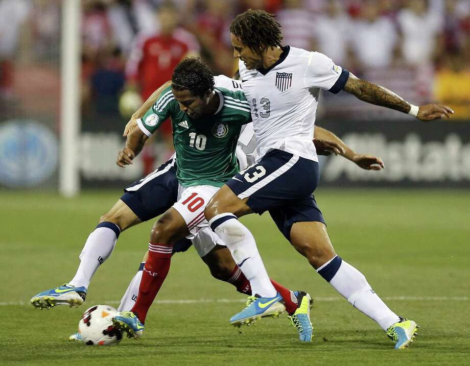 Jermaine Jones (13) of the United States  and Landon Donovan (10) defend against Giovani dos Santos of Mexico in the second half during 2014 FIFA World Cup Qualifying at Columbus Crew Stadium in Columbus, Ohio, on Tuesday, September 10, 2013. The U.S. won, 2-0. (Kyle Robertson/Columbus Dispatch/MCT) Photo: Kyle Robertson, McClatchy-Tribune News Service / Columbus Dispatch