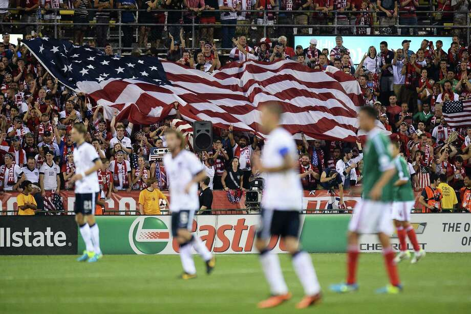 COLUMBUS, OH - SEPTEMBER 10:  Fans unfurl a large U.S. flag after the U.S. Men's National Team scored their second goal against Mexico in the second half at Columbus Crew Stadium on September 10, 2013 in Columbus, Ohio. The United States defeated Mexico 2-0. Photo: Jamie Sabau, Getty Images / 2013 Getty Images