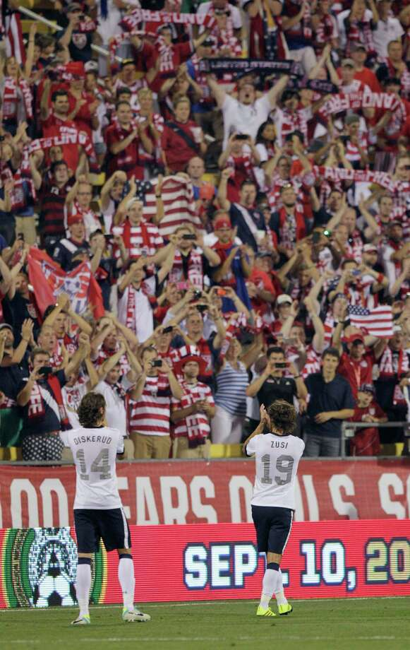 United States' Mix Diskerud, left, and Graham Zusi celebrate the team's 2-0 win over Mexico in a World Cup qualifying soccer match Tuesday, Sept. 10, 2013, in Columbus, Ohio. (AP Photo/Jay LaPrete) Photo: Jay LaPrete, Associated Press / FR52593 AP