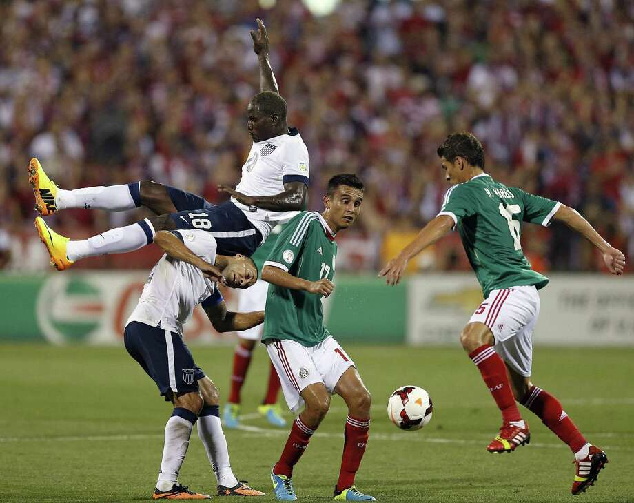 Eddie Johnson (18) of the United States is pushed into teammate Clint Dempsey while going up against Jesœs Zavala (17) of Mexico in the second half during 2014 FIFA World Cup Qualifying at Columbus Crew Stadium in Columbus, Ohio, on Tuesday, September 10, 2013. The U.S. won, 2-0. (Kyle Robertson/Columbus Dispatch/MCT) Photo: Kyle Robertson, McClatchy-Tribune News Service / Columbus Dispatch