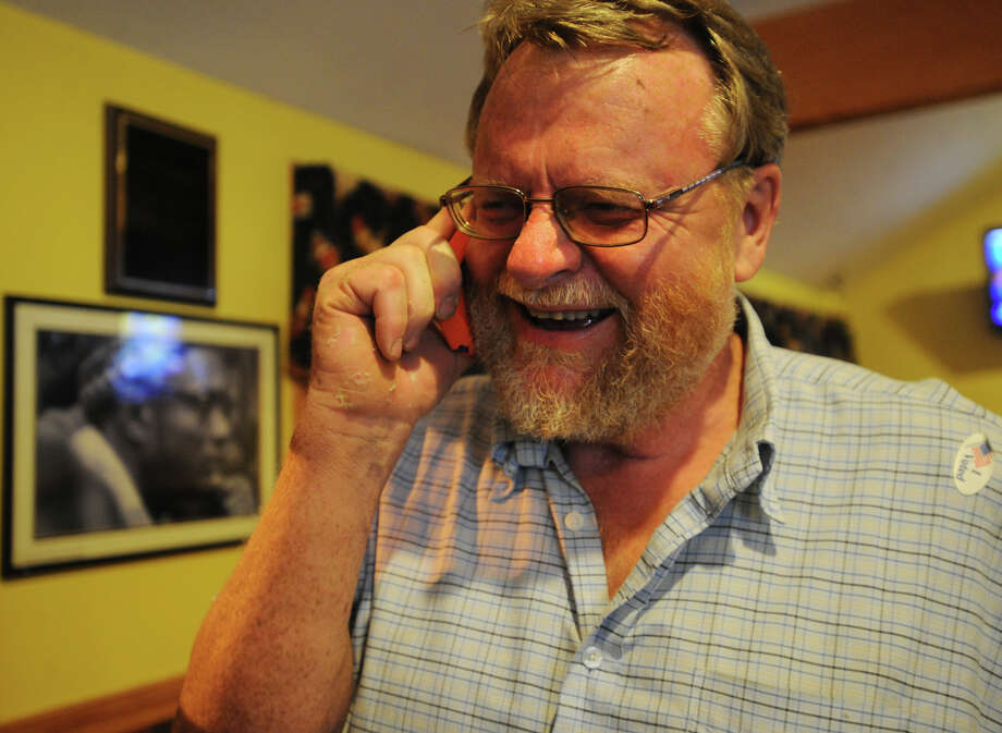 Bob Halstead receives a congratulatory phone call at the Red Rooster Deli in Bridgeport, Conn., after winning the Democratic primary in the 132nd District for Bridgeport City Council on Tuesday, September 10, 2013. Photo: Brian A. Pounds / Connecticut Post