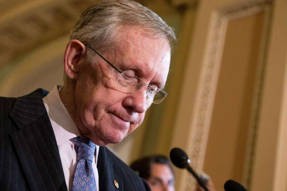 """""""Now that the bill for Republicans' own excesses  has come due – the bill for wars they supported and tax cuts they  created – they want to walk out on the check,"""" Senate Majority Leader Harry Reid of Nevada. Photo: J. Scott Applewhite, STF / AP"""