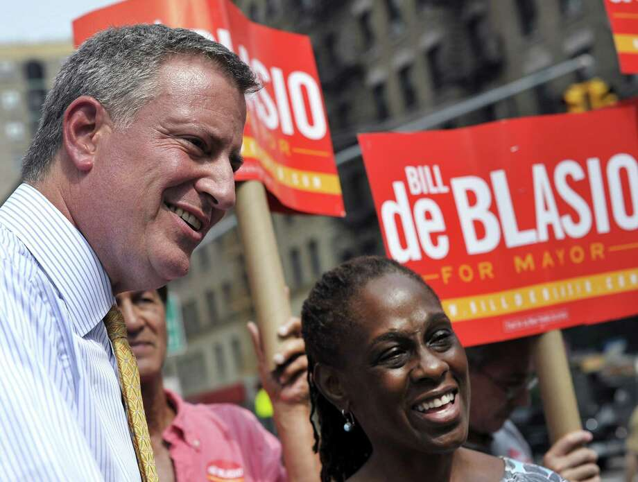 Bill de Blasio, New York City's public advocate and  frontrunner among Democratic candidates for mayor, greets voters on the Upper West side along with his wife Chirlane McCray on September 10 , 2013 during  the primary vote for New York City's Democratic candidate for mayor.   AFP PHOTO / TIMOTHY CLARYTIMOTHY CLARY/AFP/Getty Images Photo: TIMOTHY CLARY / AFP