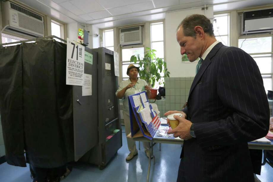 Democratic comptroller hopeful Eliot Spitzer waits his turn to cast his vote in the primary election at his polling station in New York, Tuesday, Sept. 10, 2013.  (AP Photo/Mary Altaffer) ORG XMIT: NYMA111 Photo: Mary Altaffer / AP