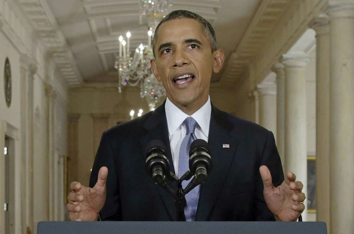 President Barack Obama, in a live televised speech from the White House on Tuesday, blended the threat of military action with the hope of a diplomatic solution as he works to strip Syria of its chemical weapons.